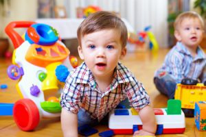 bigstock-curious-baby-boy-studying-nurs-42451435-e1409850135499